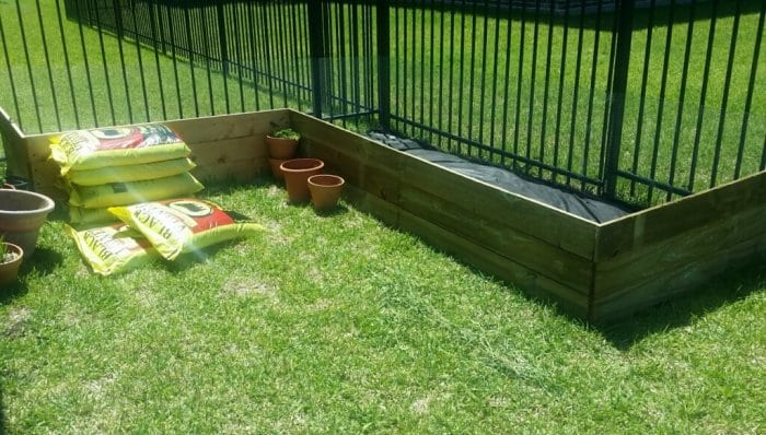 Elevated garden beds using reclaimed wood